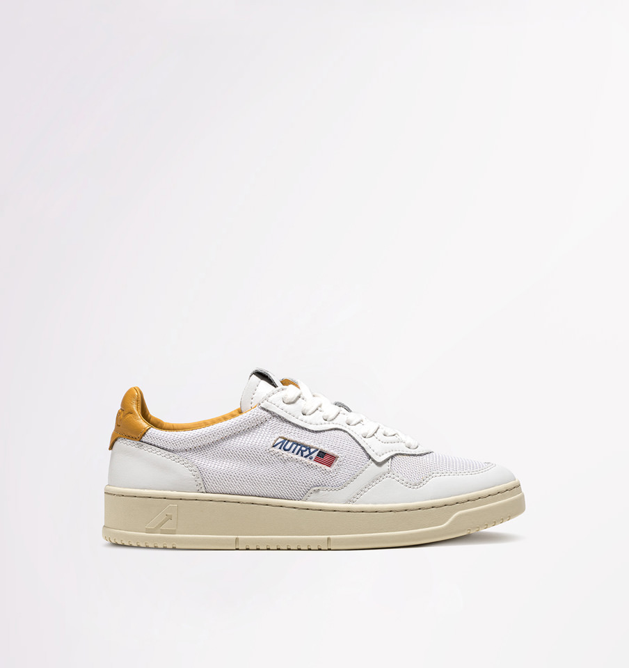 AUTRY: LOW SNEAKERS IN WHITE OCHRE YELLOW FABRIC
