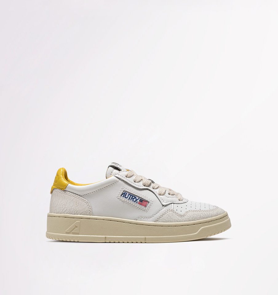 AUTRY: LOW SNEAKERS IN LEATHER AND CRACKLE EFFECT LEATHER COLOR WHITE YELLOW