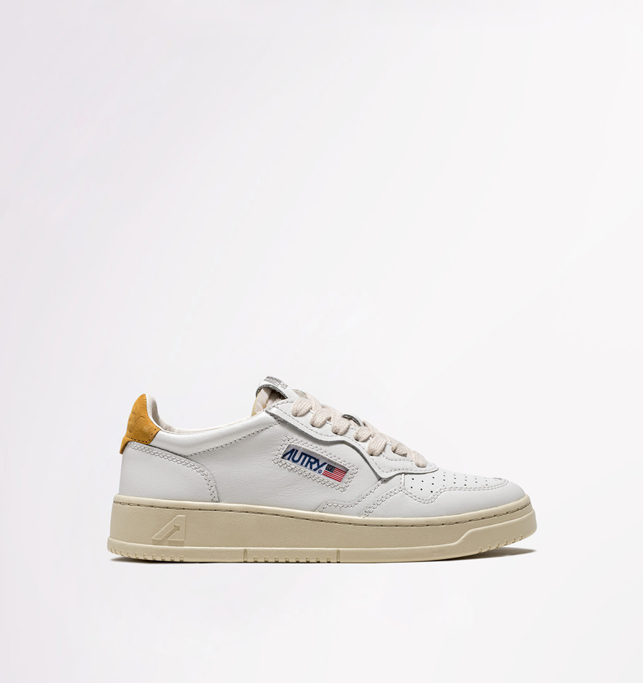 AUTRY: LOW SNEAKERS IN WHITE OCHRE YELLOW LEATHER