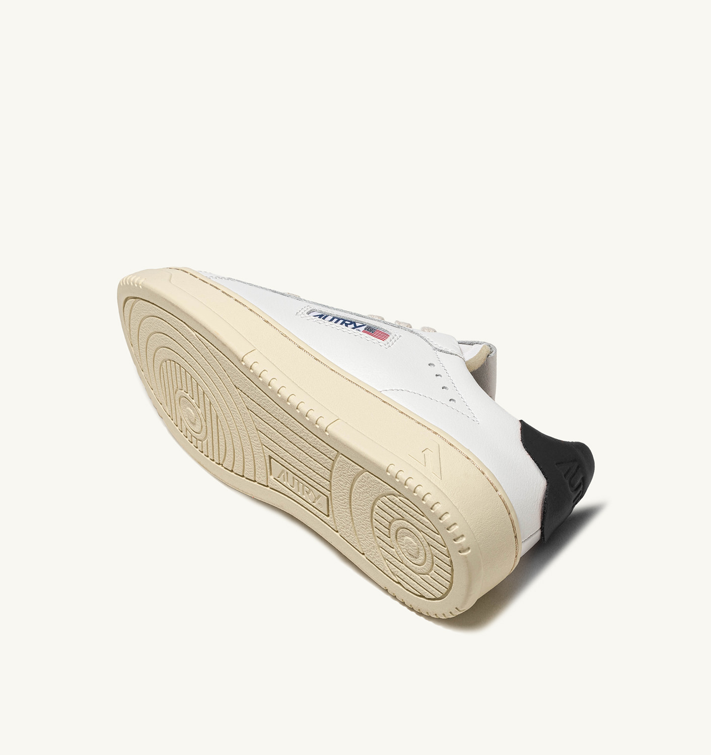AUTRY: DALLAS LOW SNEAKERS IN LEATHER COLOR WHITE BLACK