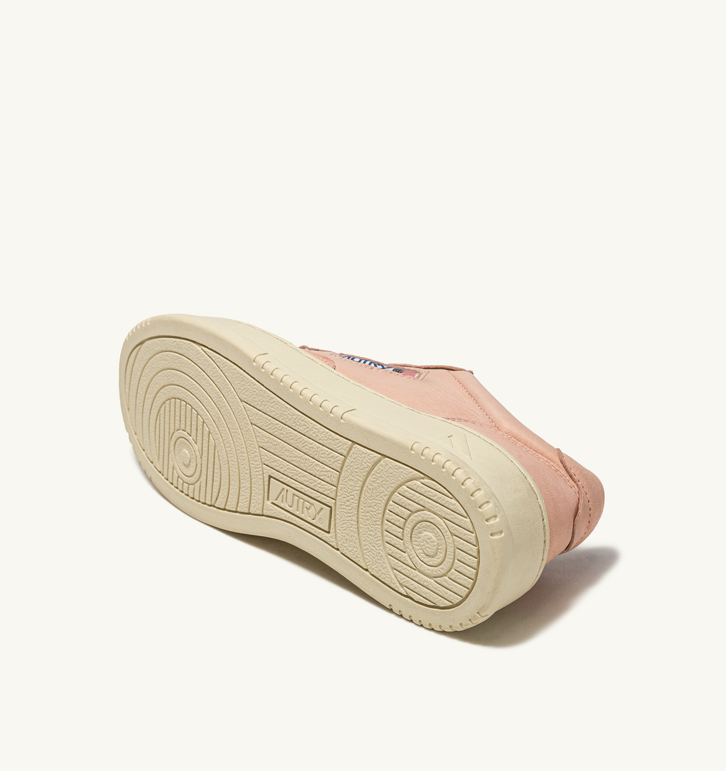 AUTRY: MEDALIST LOW SNEAKERS IN GOAT SKIN COLOR PINK